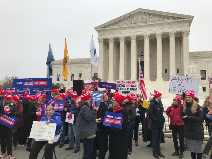 Advocates gather outside the U.S. Supreme Court in Washington D.C. Monday.